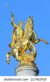 TBILISI, GEORGIA - AUGUST 16, 2014: Sculpture of St George on the top of Freedom Monument on the Freedom Square. The monument by Georgian sculptor Zurab Tsereteli was unveiled on November 23, 2006.