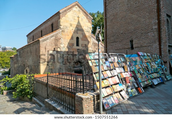 Tbilisi, Georgia - August 19, 2019: a colorful stand of old books outside the courtyard of Anchiskhati's basilica