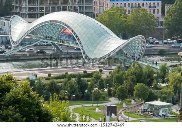 Tbilisi, Georgia - August 19, 2019: the Bridge of Peace, designed by the Italian architect Michele De Lucchi