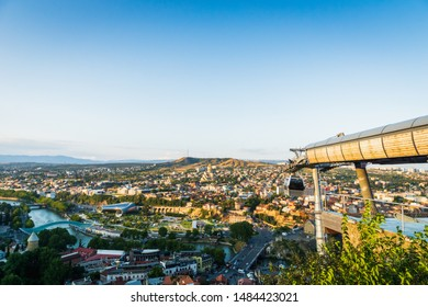 Tbilisi, Georgia - August 2019. Tbilisi downtown and old town aerial from Tbilisi funicular in the capital of Georgia at sunset. Tbilisi is the capital and the largest city of Georgia.