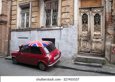 TBILISI, GEORGIA â?? August 29, 2015: Red  MINI Cooper on one of the streets in the Old Town of Tbilisi. Photo taken on: August 29th, 2015.