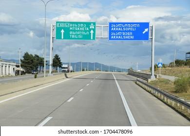 Tbilisi, Georgia - August 8, 2019: Georgian highway with sign to the places: Mtskheta, Tbilisi, Akhalsopeli and Akhalsheni