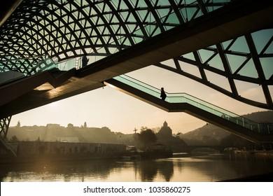 Tbilisi Georgia, bridge of peace is a bow-shaped pedestrian bridge, a steel and glass construction illuminated with numerous LEDs, over the Kura River in downtown Tbilisi, capital of Georgia