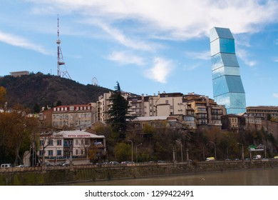 Tbilisi, Georgia - December 02, 2018: Biltmore Millennium Hotel and view of Mount Mtatsminda.