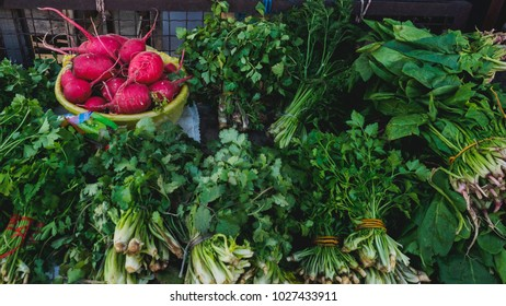 Tbilisi, Georgia. dezerter bazaar, city food market. Fresh herbs, cilantro leaves, radish close up - Shutterstock ID 1027433911