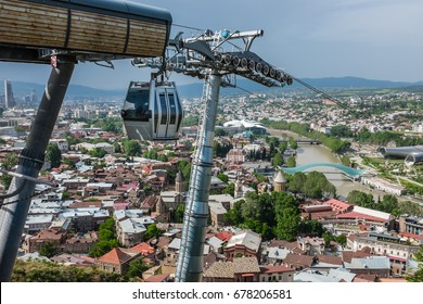 TBILISI, GEORGIA, EASTERN EUROPE - Aerial tramway cable car running from the terminus at Narikala to Rike Park over Old Tbilisi.