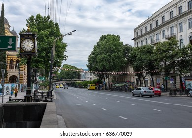 TBILISI, GEORGIA, EASTERN EUROPE - JULY 12TH, 2015 : Street clock and pedestrian underpass entrance on Shota Rustaveli Avenue in central Tbilisi.