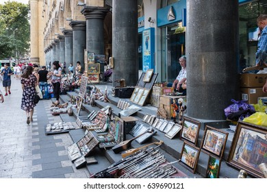 TBILISI, GEORGIA, EASTERN EUROPE - JULY 25TH, 2015 : Street vendors selling souvenirs on Rustaveli Avenue in central Tbilisi.