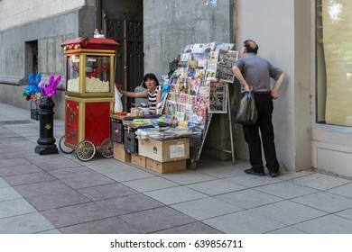 TBILISI, GEORGIA, EASTERN EUROPE - JULY 16TH, 2015 : Street vendor selling pop corn on Rustaveli Avenue in central Tbilisi.