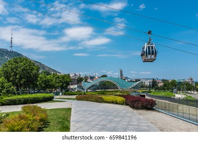 TBILISI, GEORGIA, EASTERN EUROPE - JULY 22nd, 2015 : Tbilisi aerial tramway cable car over Rike Park and the Bridge of Peace.