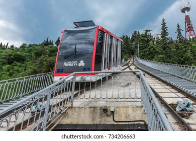TBILISI, GEORGIA, EASTERN EUROPE - JULY 15TH, 2015 : Funicular Railway running from a station on Chonquadze Street up to Mtatsminda Mountain above the city of Tbilisi.
