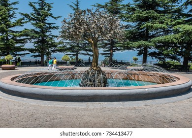 TBILISI, GEORGIA, EASTERN EUROPE - JULY 15TH, 2015 : Central fountain and trees in Mtatsminda Park located high above the city of Tbilisi and reached by using the Funicular railway.