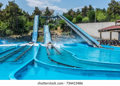 TBILISI, GEORGIA, EASTERN EUROPE - JULY 15TH, 2015 : Water slide amusement ride at Mtatsminda Park on Mtatsminda mountain overlooking the city of Tbilisi.