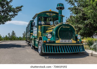 TBILISI, GEORGIA, EASTERN EUROPE - JULY 15TH, 2015 : Happy Train Deltrain model tourist train in the Mtatsminda Park, Tbilisi used for carrying visitors around the park complex.