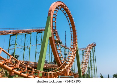 TBILISI, GEORGIA, EASTERN EUROPE - JULY 15TH, 2015 : Colorful Roller coaster ride located in the Mtatsminda Park on the mountain above the city of Tbilisi.
