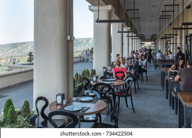 TBILISI, GEORGIA, EASTERN EUROPE - JULY 10TH, 2015 : Funicular complex at Mtatsminda Park overlooking the city of Tbilisi consisting of restaurants and the station for the Funicular railway.
