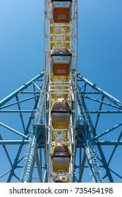 TBILISI, GEORGIA, EASTERN EUROPE - JULY 15TH, 2015 : Passenger cabins on the big ferris wheel amusement park ride located at Mtatsminda Park Funicular complex.