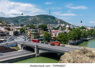 TBILISI, GEORGIA, EASTERN EUROPE - JULY 22ND, 2015 : View across the River Mtkvari over the Old Town district towards the Tbilisi TV Tower on Mtatsminda mountain.