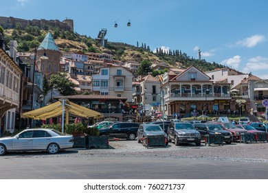 TBILISI, GEORGIA, EASTERN EUROPE - JULY 22ND, 2015 : View towards the Old Town district of Tbilisi with Narikala Fortress and cable cars on the hilltop behind.