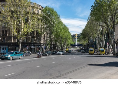 TBILISI, GEORGIA, EASTERN EUROPE - MAY 6TH, 2015 : Shota Rustaveli Avenue in Tbilisi towards Freedom Square and the Monument of Freedom and Victory, fountain with statue of St George slaying dragon.