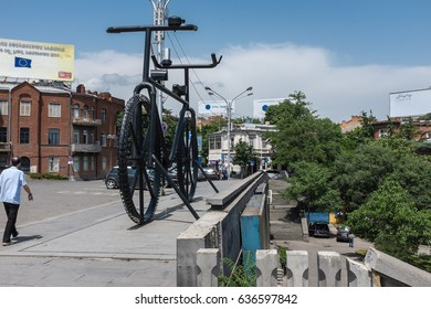 TBILISI, GEORGIA, EASTERN EUROPE - MAY 31ST, 2015 : Giant black bicycle sculpture in Rose Revolution Square.