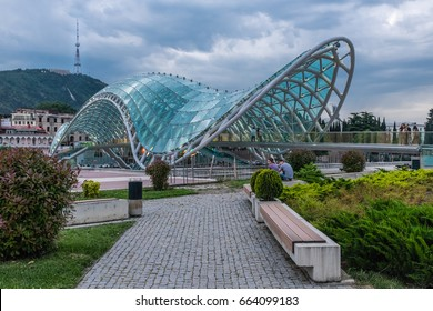 TBILISI, GEORGIA, EASTERN EUROPE - MAY 27TH, 2015 : Peace Bridge straddling the Mtkvari River connecting Old Tbilisi to the new district.