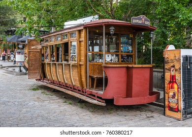 TBILISI, GEORGIA, EASTERN EUROPE - MAY 29TH, 2015 : Small bar made from an old tram carriage or konka (horsecar) in the Old Town sector of the city.