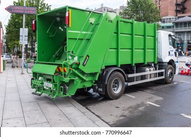 TBILISI, GEORGIA, EASTERN EUROPE -MAY 26th, 2015 : Green refuse truck collecting rubbish on the city streets.