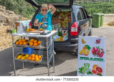 TBILISI, GEORGIA, EASTERN EUROPE -MAY 29th, 2015 : Man preparing and selling fresh fruit juices at Narikala on a summers day.