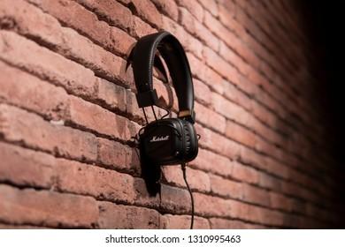 Tbilisi / Georgia - January 24, 2019: Marshall headphones hanging on a brick background