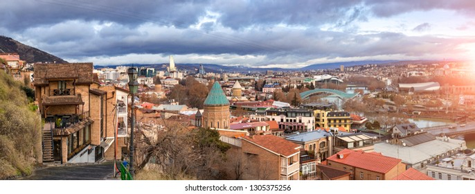 Tbilisi, Georgia - January 28 2019:  view of old historical part of Tiflis district with orthodox church roof. Morning sunrise bright sunlight. Orange roofs. Sightseeings