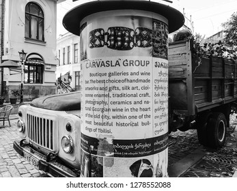 TBILISI, GEORGIA - July 10, 2018: The big column on the Shardeni street in old Tbilisi to announce some event in the capital.
