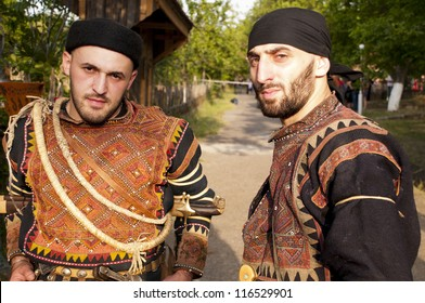 TBILISI, GEORGIA - JULY 18: Two men in costumes of region Khevsureti pose at Art Gene Folk festival at the ethnographic museum on JULY 18, 2011 in Tbilisi