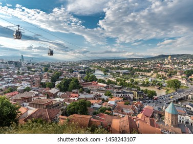Tbilisi, Georgia - July 2019: Aerial panoramic view from Narikala Fortress, aerial cable car, old town, Bridge of Peace, Fuksas music theatre exhibition hall, Kura river, Rike Park