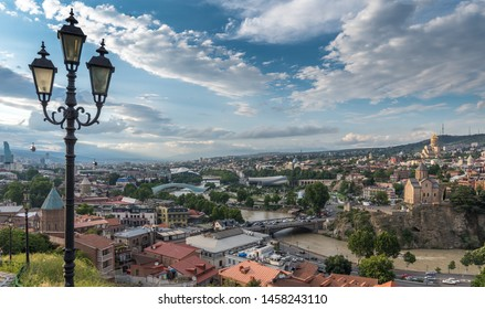Tbilisi, Georgia - July 2019: Aerial panoramic view from Narikala Fortress, aerial cable car, old town, lamppost, Bridge of Peace, Fuksas music theatre exhibition hall, Kura river, Rike Park