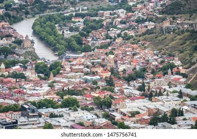 Tbilisi, Georgia - July 2019: Beautiful aerial view of Tbilisi Jewish quarter district and Kura River from Mtatsminda Park