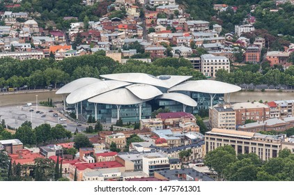 Tbilisi, Georgia - July 2019: Beautiful aerial view of Tbilisi city center, Public Service Hall, from Mtatsminda Park. Modern architecture