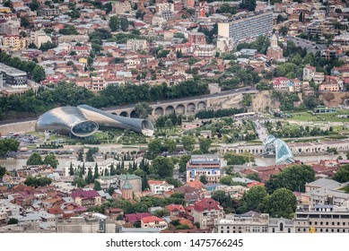 Tbilisi, Georgia - July 2019: Beautiful aerial view of Tbilisi city center from Mtatsminda Park: Rike concert hall, Bridge of Peace