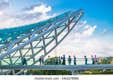 Tbilisi, Georgia - July 25 2019: Bridge of Peace in Tbilisi. Pedestrian bridge of steel and glass in Rike Park.