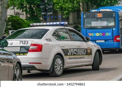 Tbilisi, Georgia - June 28 2019: Police car on the asphalt road in the city on a sunny clear day