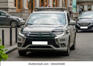 Tbilisi, Georgia - June 28, 2019: police car with lighthouses turned off on an asphalt road in the city on a sunny clear day