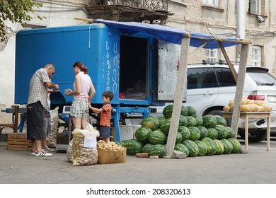 TBILISI, GEORGIA - JUNE 29, 2014: Man selling melons on a fruit stand on June 29, 2014 in Tbilisi, Georgia, East Europe