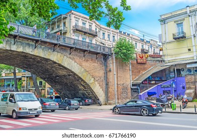 TBILISI, GEORGIA - JUNE 6, 2016: The cars ride under the Dry bridge, the place, famous among the tourists, visiting Flea Market, on June 6 in Tbilisi.