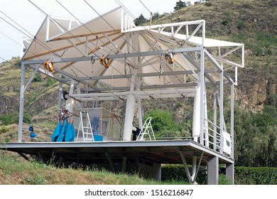 Tbilisi, Georgia - June 6, 2019: Zipline speed track for extreme descent. The zipline descent starts on the territory of the Narikala fortress, the stop - at the bottom of the Botanical Garden.