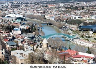 TBILISI, GEORGIA - MARCH 20, 2017:Panoramic view of Peace Bridge in Summer Rike Park in Tbilisi. Georgia on Mar 20 in Tbilisi.