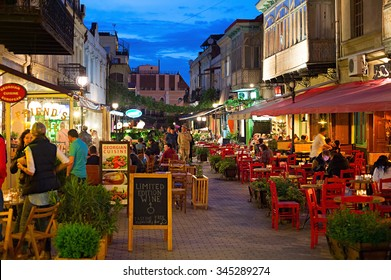 TBILISI, GEORGIA - MAY 02, 2015: People at restaurant in the Old Town of Tbilisi. Tbiisi is the capital of Georgia and the largest city in Georgia