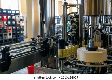 Tbilisi, Georgia - May 1, 2018: Automatic labeling machine equipment at Bagrationi factory of sparkling wine