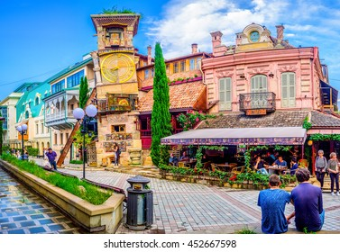 TBILISI, GEORGIA - MAY 28, 2016: The leaning clock tower of Rezo Gabriadze Puppet Theatre with the art cafe from the right, on May 28 in Tbilisi.