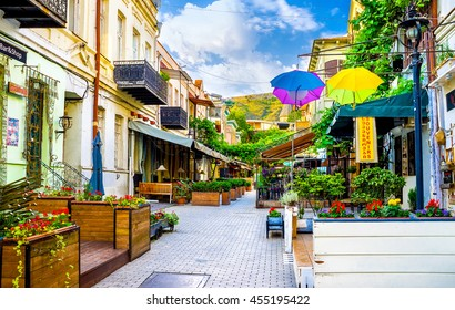 TBILISI, GEORGIA - MAY 28, 2016: The beautiful tourist street, full of cafes and restaurants with outdoor patios, decorated with flowers, sign boards and colorful umbrellas, on May 28 in Tbilisi.