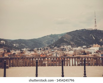 TBILISI, GEORGIA - Murch 16, 2019: Scenic panoramic view of Tbilisi. New modern architecture is adjacent to the old quarters.
